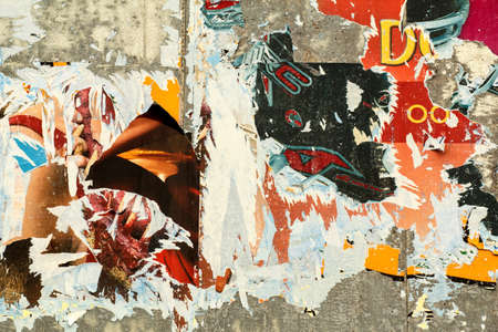 grunge background on billboard with old torn posters  Banco de Imagens