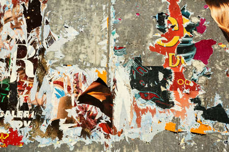 grunge background on billboard with old torn posters  写真素材