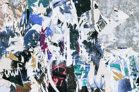 grunge background on billboard with old torn posters  스톡 콘텐츠