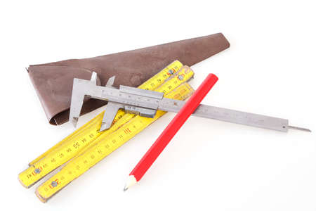 Set of measuring tools including folding ruler, vernier caliper and pencil Stock Photo - 15560982
