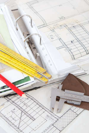 Architectural plans of the old paper tracing paper measuring tools and file with the project Stock Photo - 15560989
