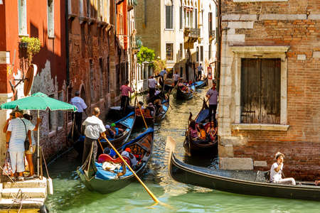 16. Jul 2012 - Tourists on gondolas at canal in Venice, Italy