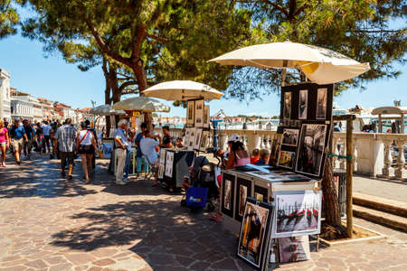 16. Jul 2012 - Street vendor selling tourist souvenirs. Most vendors in Venice aren't of Italian origin.  Stock Photo - 15855219