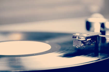 Spinning vinyl record. Motion blur image.  Vintage toned. Shallow depth of field.
