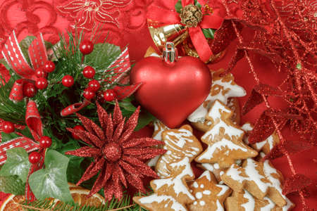 background with red heart,and gingerbreads on red photo