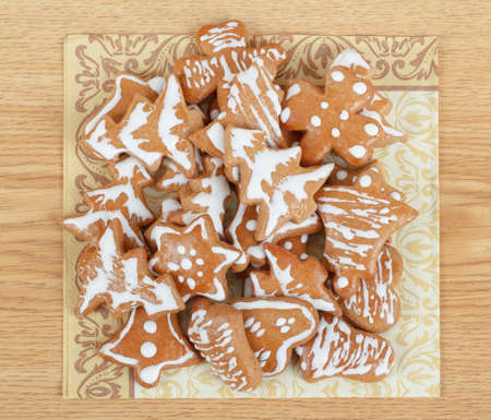 homemade christmas gingerbreads on wooden table photo