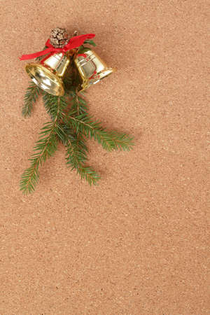 corkboard with christmas bels and needles decorations for santa message photo