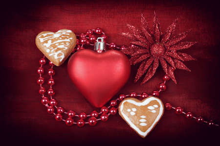 valentine hearts, flower and jewelery on red background photo