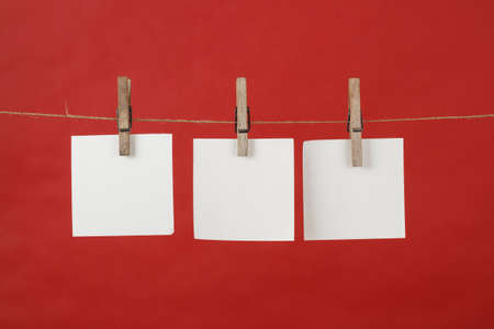 memory note paper hanging on cord on red background photo