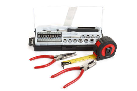 DIY work tools, screwdriver toolbox with set of bits, pliers and measuring tape Stock Photo - 17191452