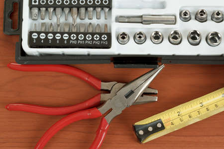 DIY work tools, screwdriver toolbox with set of bits, pliers and measuring tape Stock Photo - 17191462