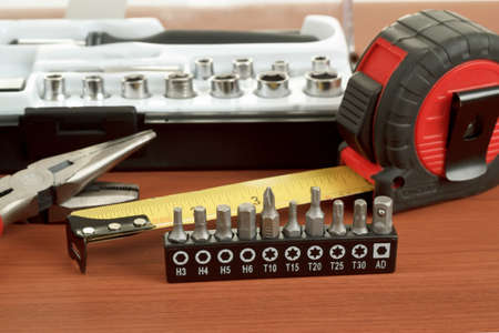DIY work tools, screwdriver toolbox with set of bits, pliers and measuring tape Stock Photo - 17191455