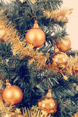 yellow decorated christmas tree on white background photo