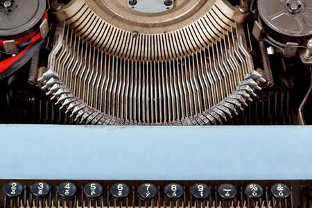 retro typewriter close up with number keys and letters mechanism photo