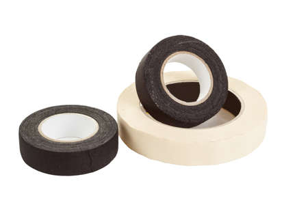 black and white insulating tapes, isolated over white background  Stock Photo - 17379237