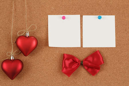 empty note for valentine message on red background photo