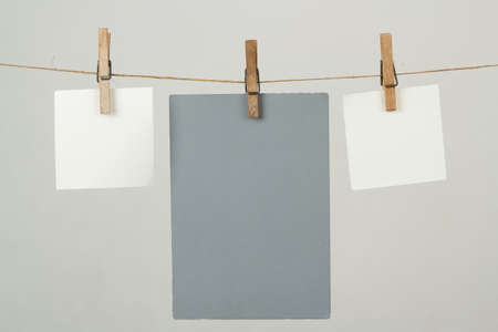 white memory note papers hanging on cord photo