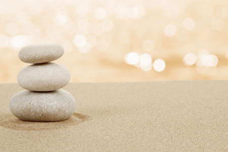 Balance zen stones in sand on white background Banco de Imagens