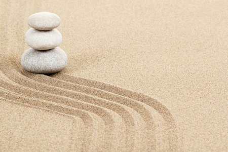 Balance of three zen stones in sand  Stock Photo - 17777331