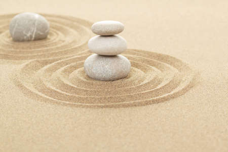 buddhism: Balance of three zen stones in sand with shallow focus Stock Photo