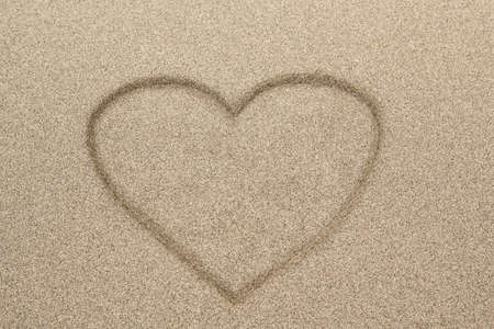 Heart shape drawn in sand for natural, symbol,tourism,holiday or conceptual designs  photo