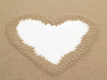 Heart shape drawn in sand with white space for text, conceptual designs  photo