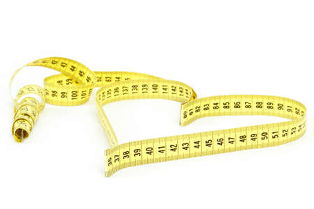 A measuring tape shaping a heart isolated on white background photo