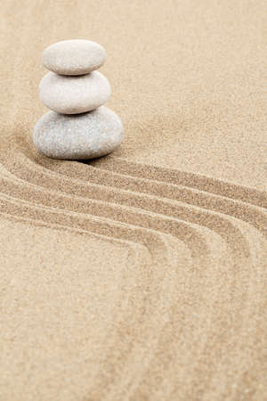 Balance of three zen stones in sand  photo