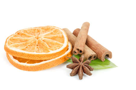 anice: Star Anise, cinnamon and dried orange and green leave isolated on white background