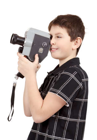viewfinder vintage: young boy with old vintage analog 8mm camera looking to viewfinder