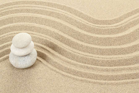 Balance of three zen stones in sand  Stock Photo