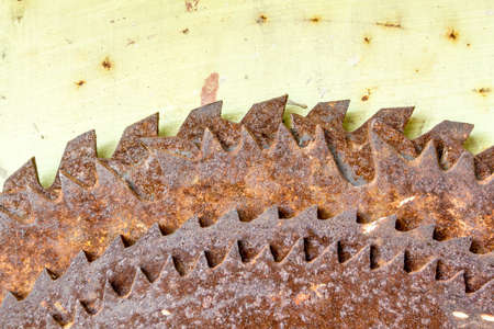 detail of old hanged rusted circular saw blades photo