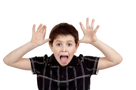 Young boy grimacing isolated on white background photo