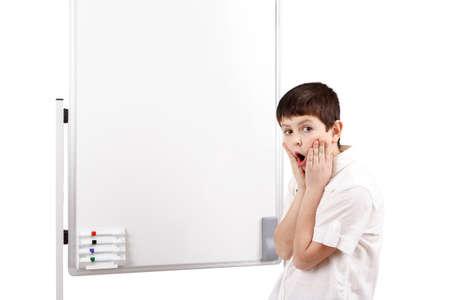 amazed little boy with white blank board isolated on white background