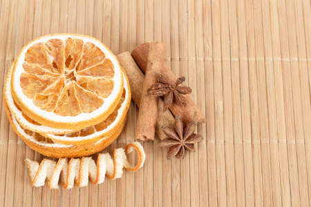 herbe: detail of Star Anise, cinnamon and dried orange  on wooden background