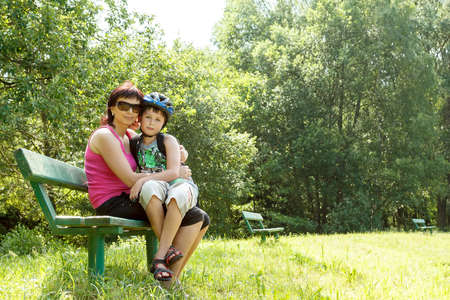Mother and her son with bicycle helmet outdoor photo