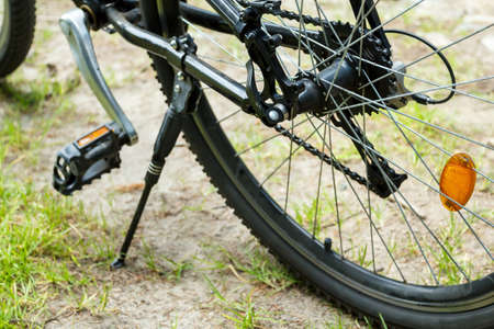 detail of mountain bike parked, shallow focus photo