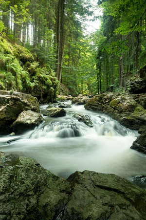 czech mountain creek Doubrava in Czech Republic with slow shutter speed photo