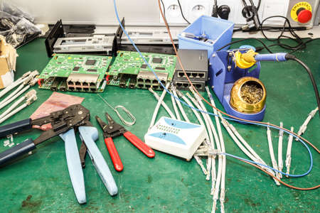 electronics equipment assembly workplace with solder and necessary tools photo