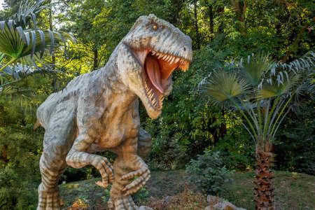 model of big tyranosaurus rex in the jungle