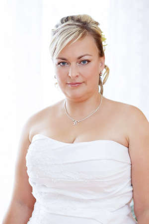 clothe: home portrait of beautiful smiling bride weared to white clothe