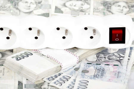 power cord and banknotes of czech crowns money concept of expensive energy bill photo
