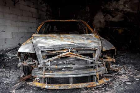 burned out: Close up photo of a burned out car in garage after fire for grunge use Stock Photo