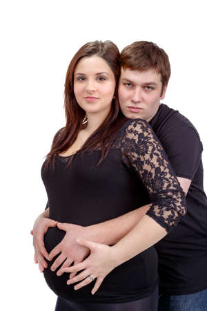 loving happy couple, pregnant woman with her husband, isolated on white  Stock Photo - 24670946