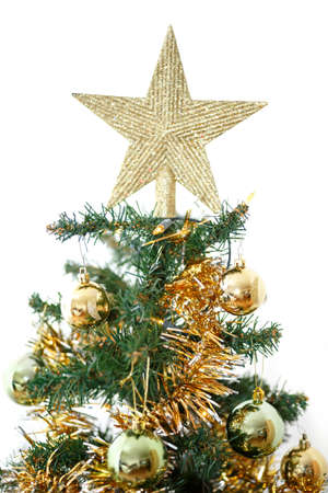 Decorated christmas tree with yellow and green balls on white background photo