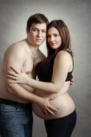Loving happy couple, pregnant woman with her husband photo