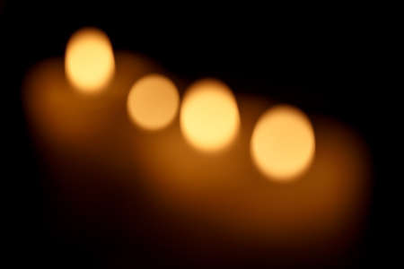 candle light: Abstract background. Blurred colorful circles bokeh of christmas candles lights