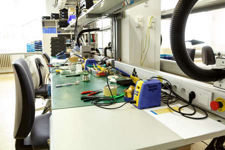 electronics equipment assembly workplace with pliers and necessary tools