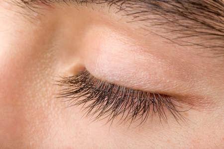 shoot of beautiful teenager man closed eye macro