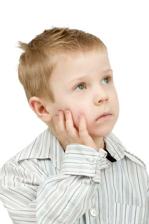 ��beautiful boy�: Studio portrait of young pensive beautiful boy on white background